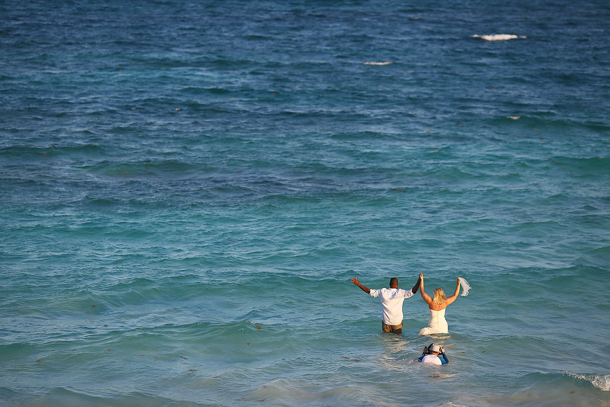 Matt Adcock shooting photographs in the caribbean ocean