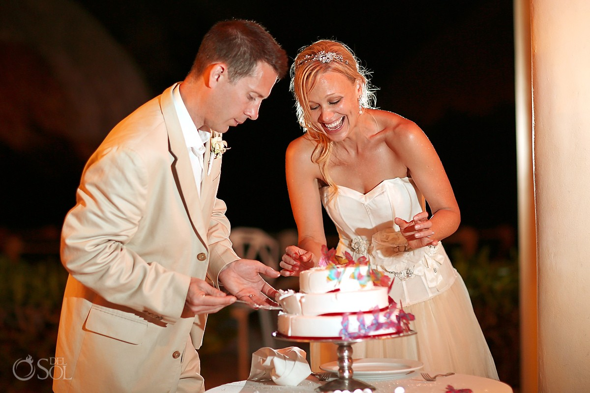 Mexico destination wedding cutting cake Dreams Tulum