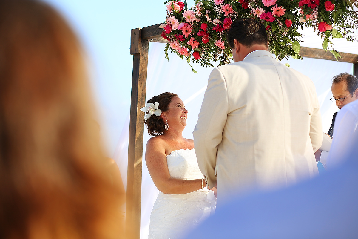Bride and groom at the altar Dreams Tulum Destination Wedding