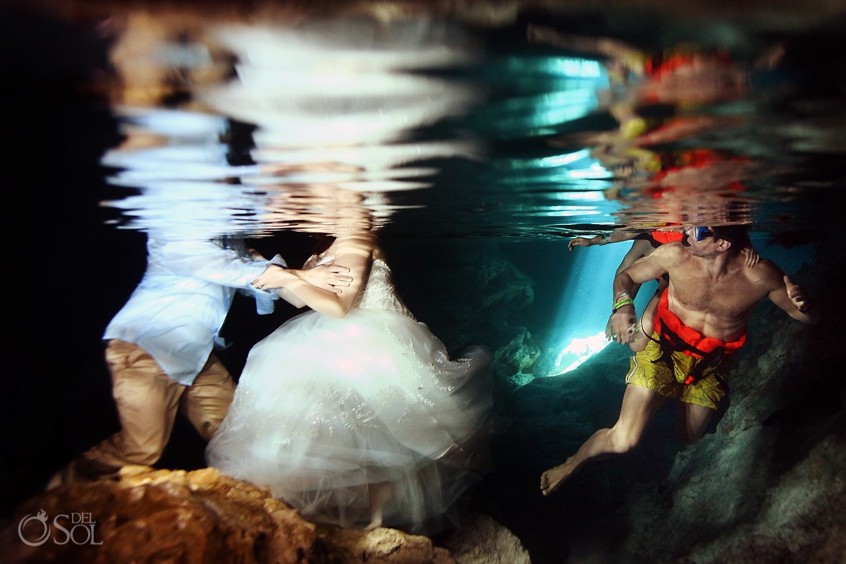 cenote trash the dress underwater photobomb