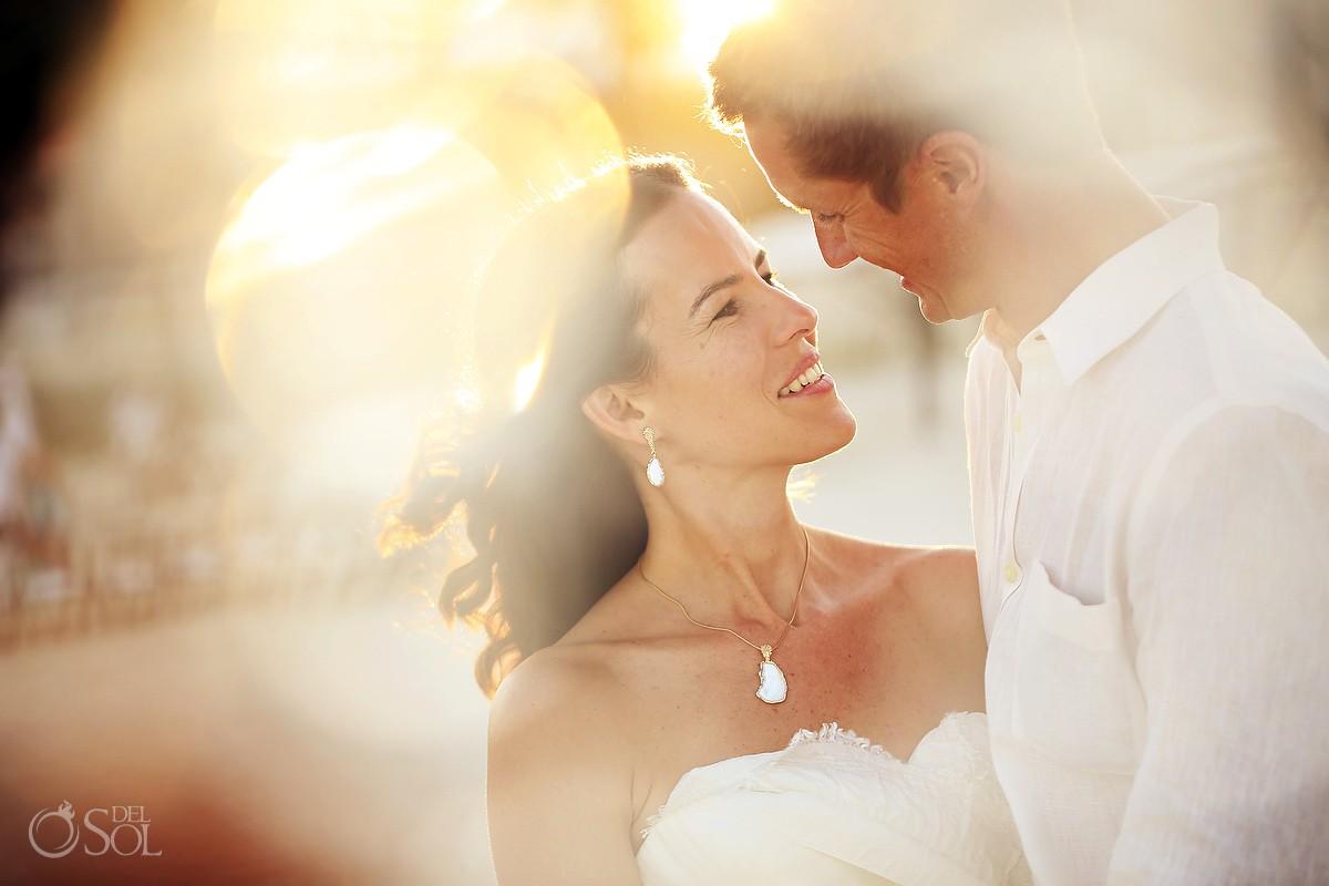 Sunny bride and groom portrait on the beach