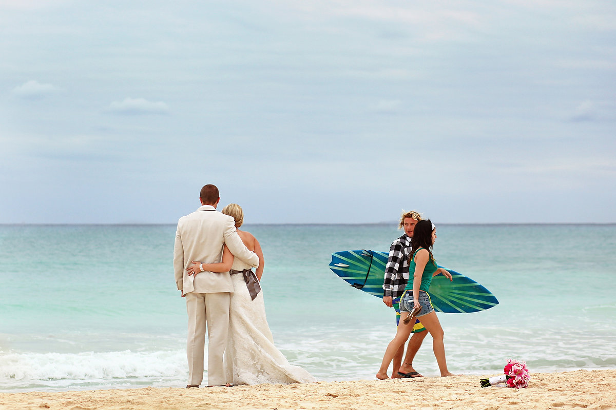 Surfers photobomb beach wedding