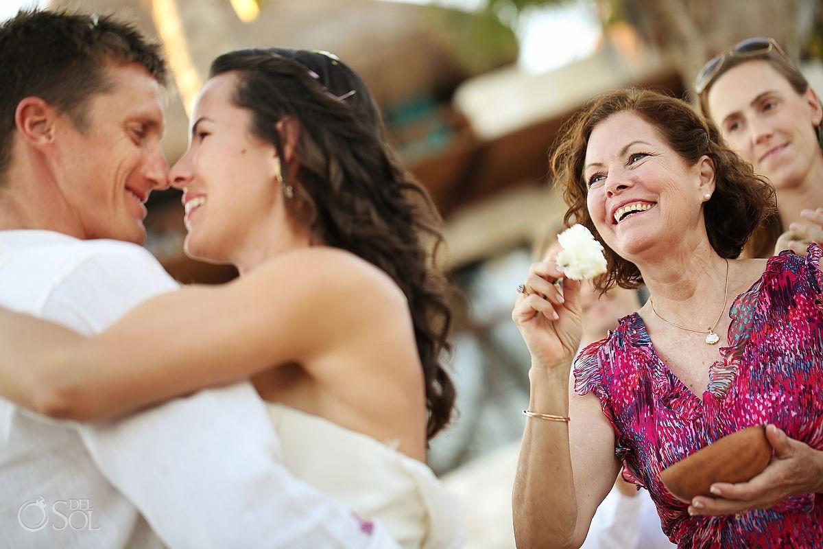Hug bride and groom beach wedding
