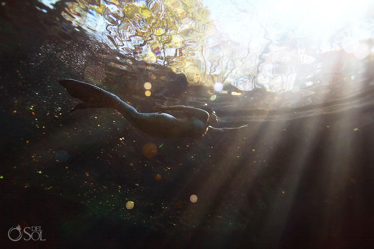 Mermaid swimming underwater cenote Riviera maya mexico