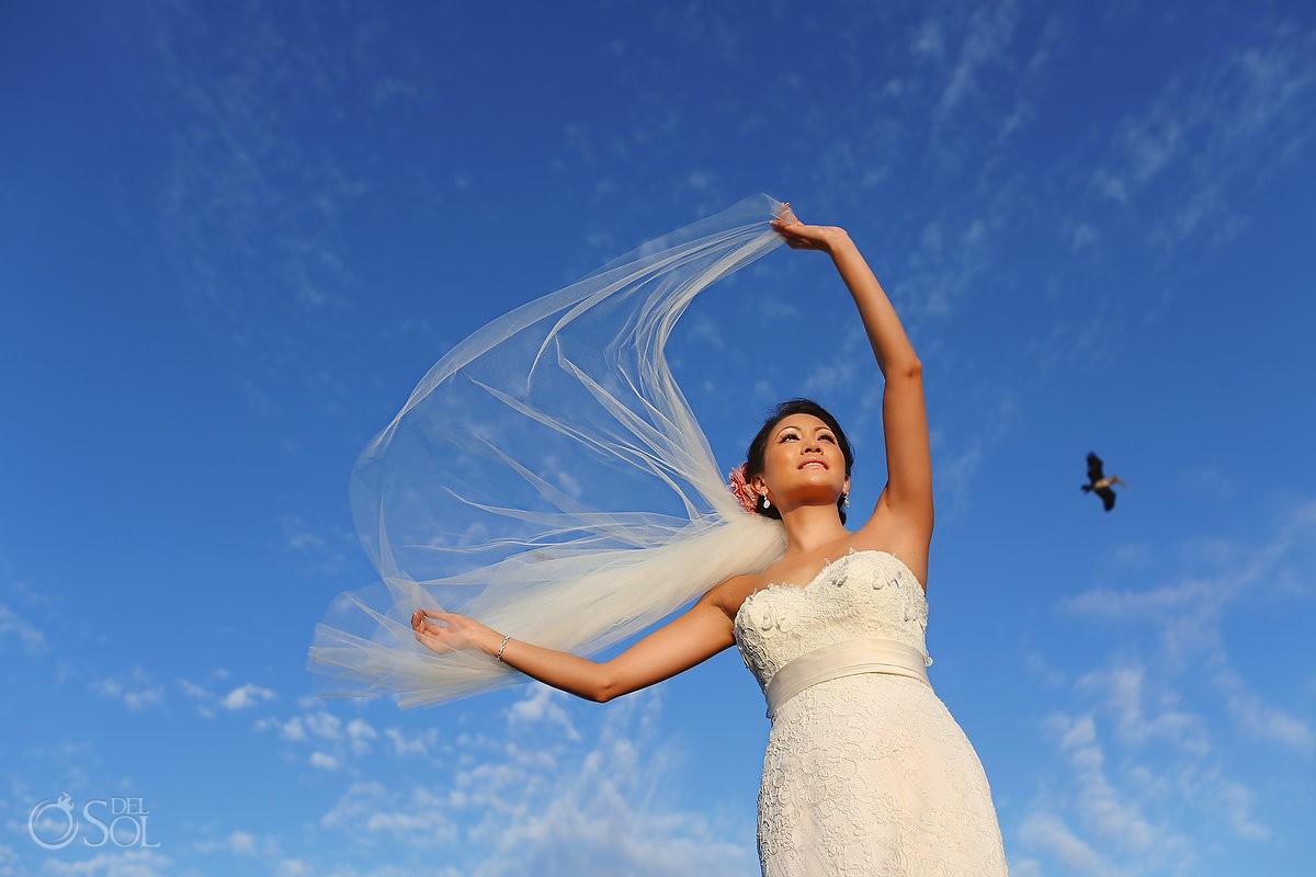 Destination wedding bride on beach