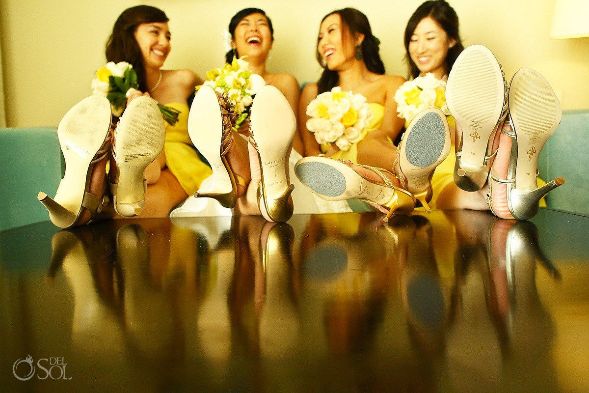 Bridesmaids laughing in yellow dresses in a destination wedding in Mexico
