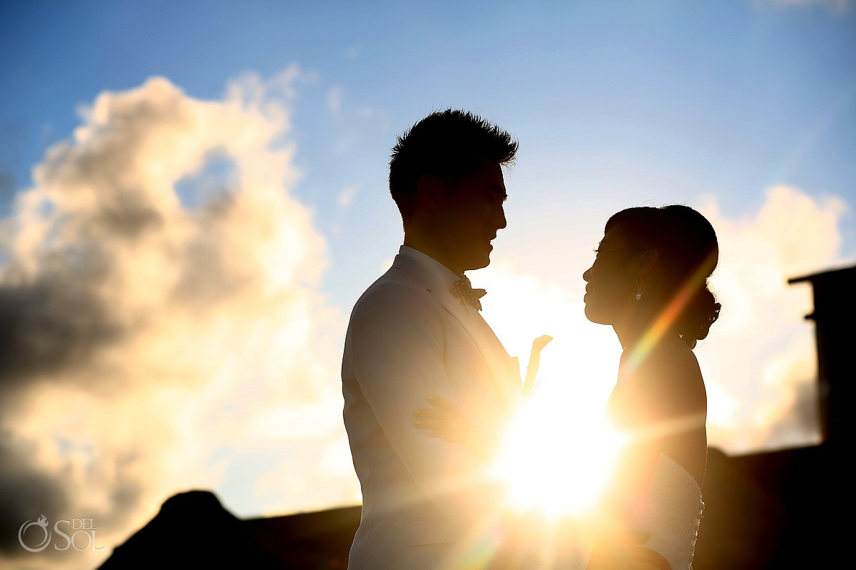 Bride and groom at sunset in the Mexican Caribbean
