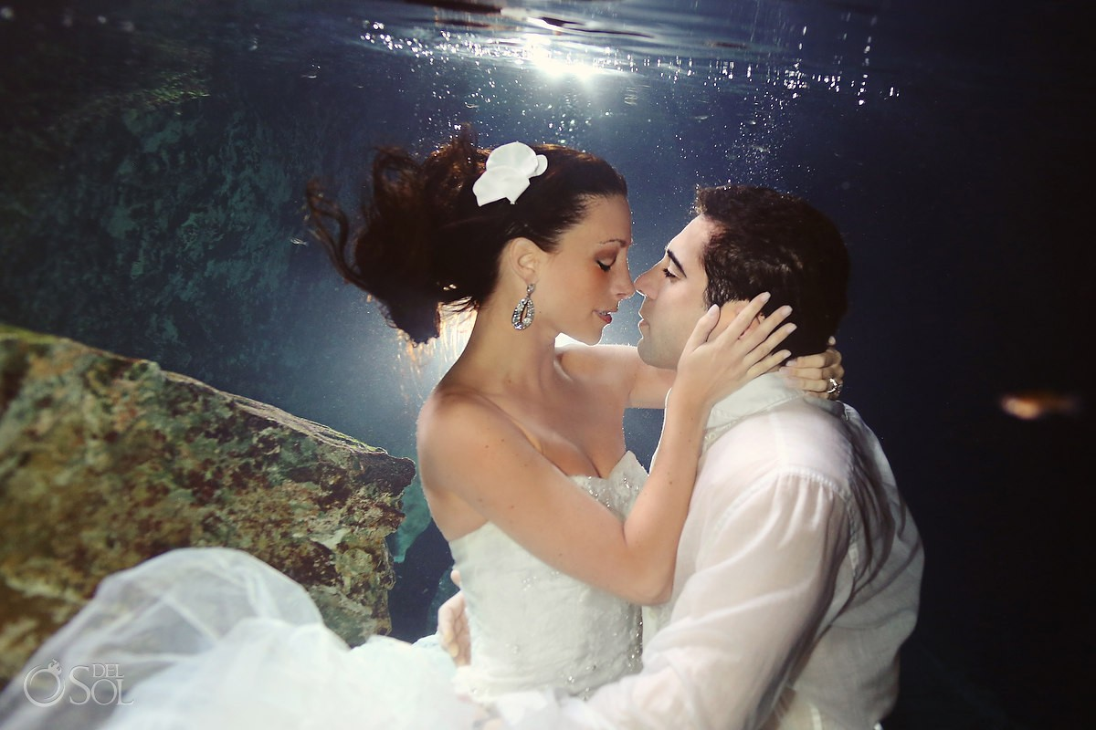 Bride and groom underwater in a cenote trash the dress photo shoot