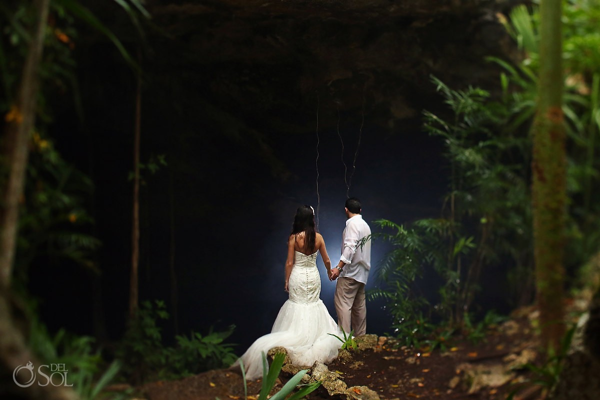 Bride and groom in the Riviera Maya cenote trash the dress