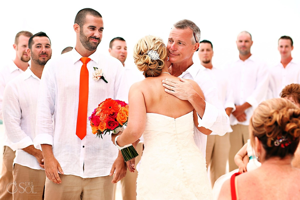 Bride and groom and family hugs at Mexico destination wedding