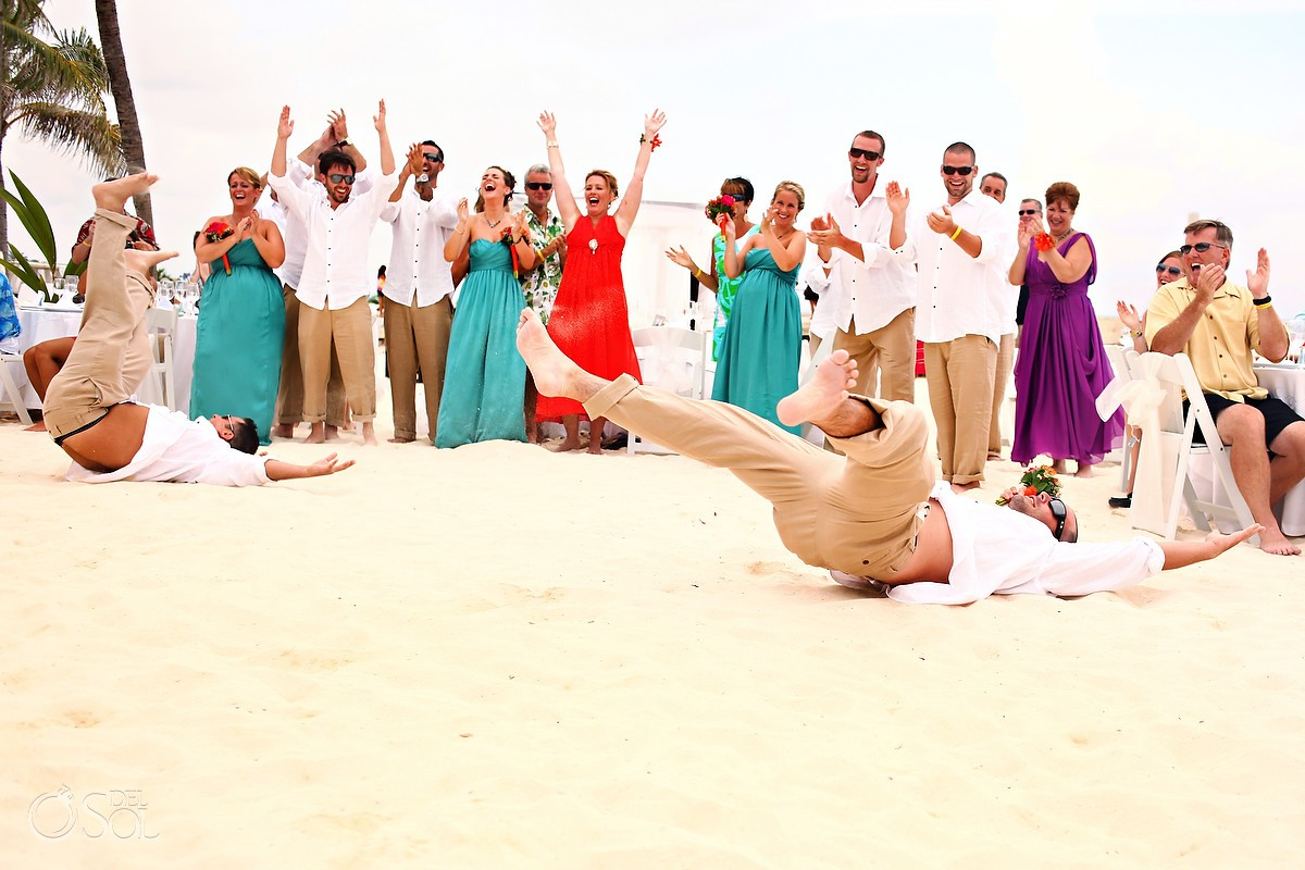 Dancing in the sand at a destination wedding reception