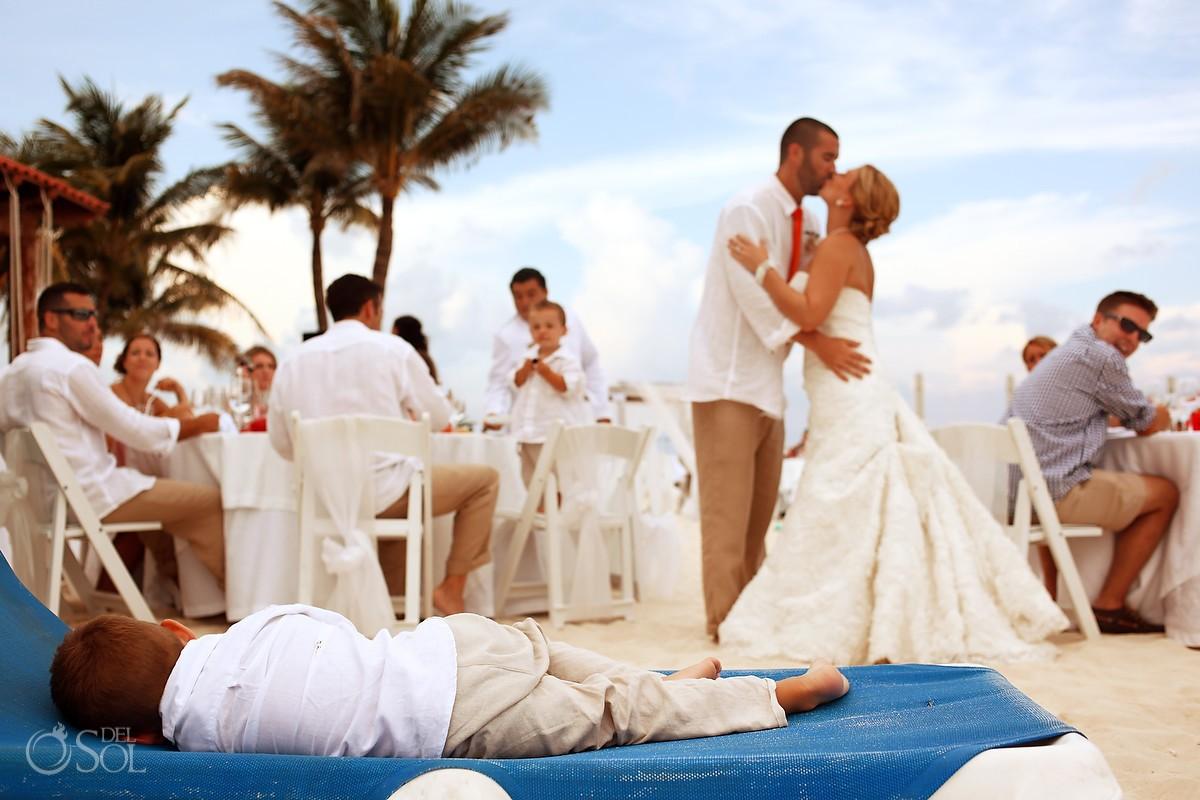 Bride and groom kiss beach palm tree Playa del Carmen