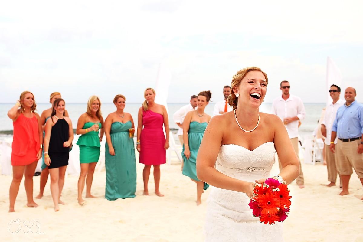 Bride throwing the bouquet beach wedding Playa del Carmen