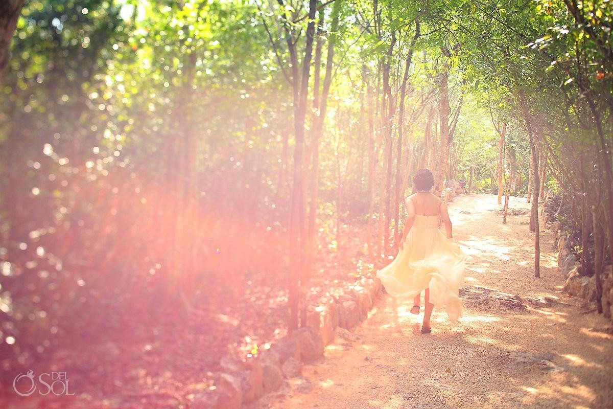 Bride running down a jungle path in Riviera Maya