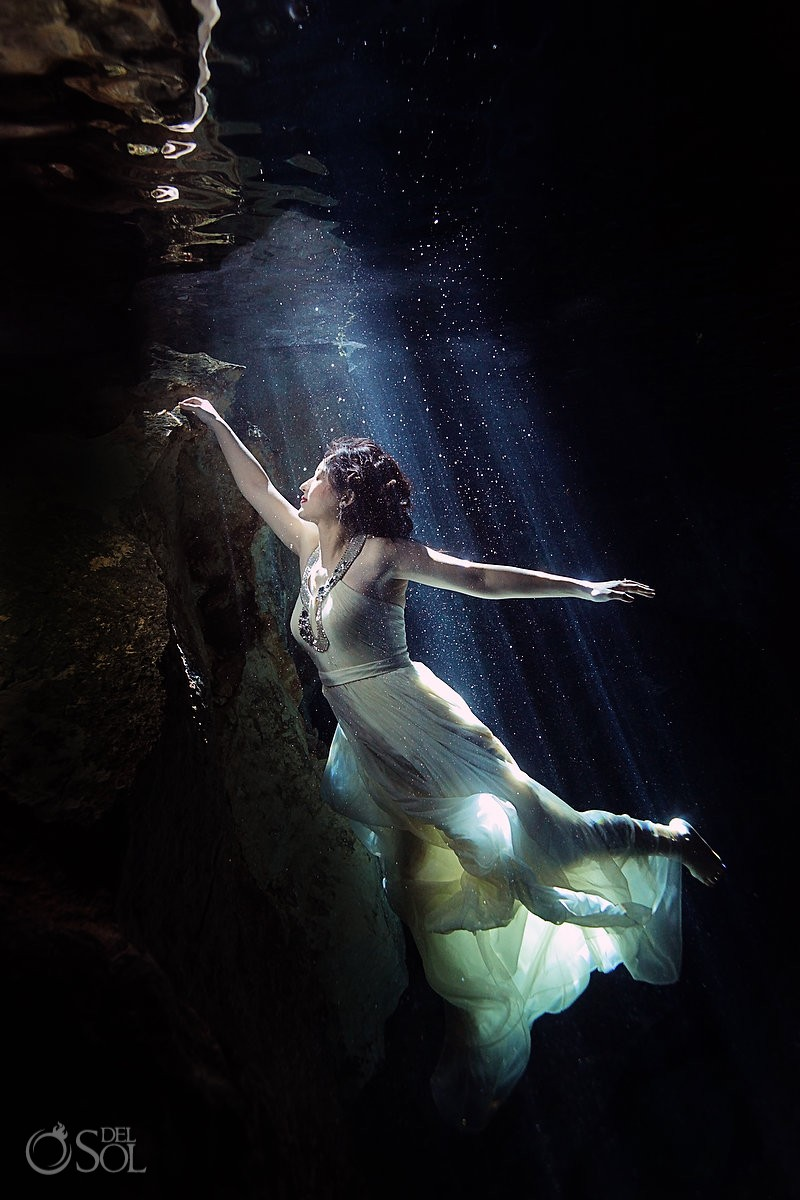 Chinese bride underwater in cenote trash the dress