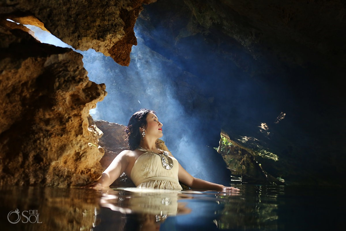 Chinese bride in cenote in the water