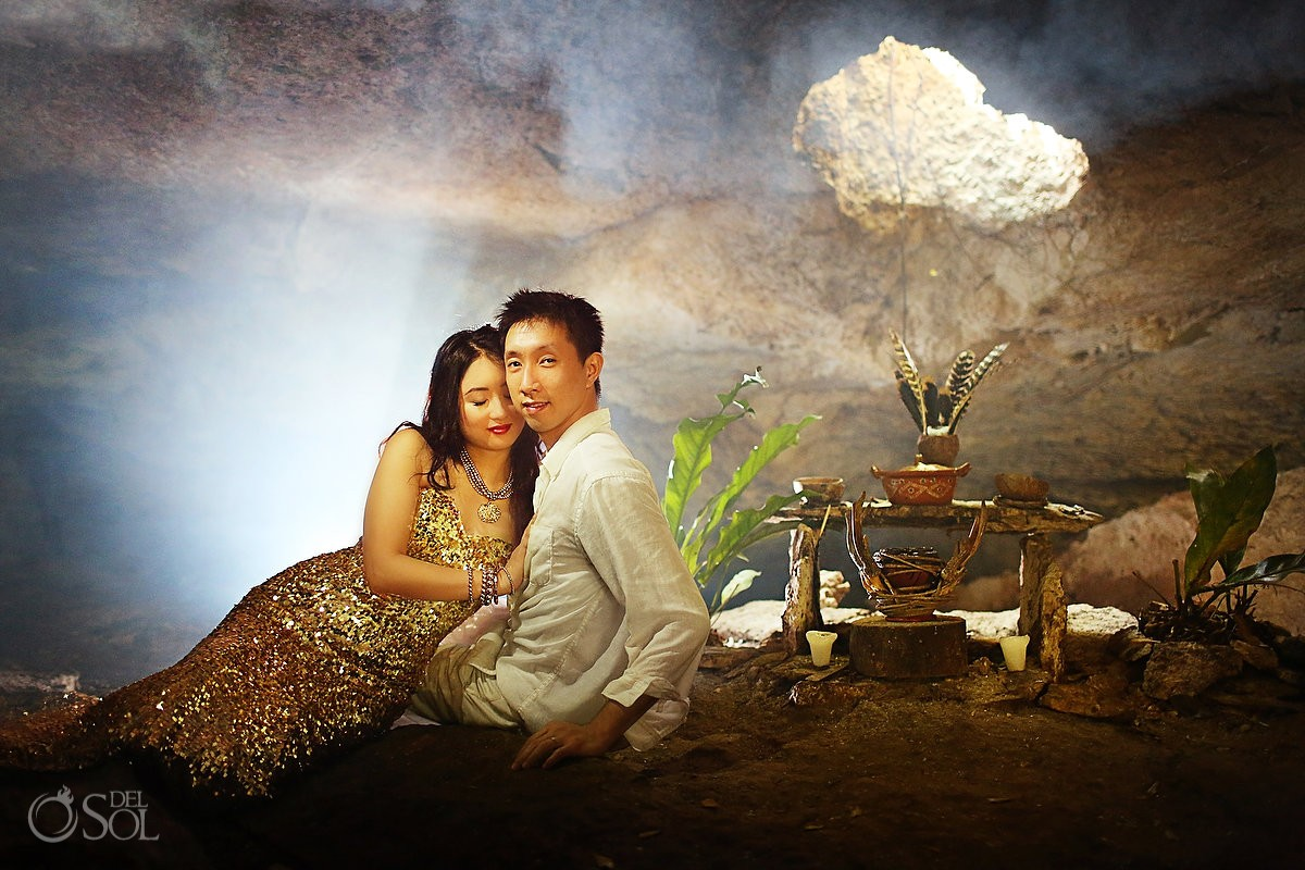 Chinese bride and groom in gold dress in a cenote