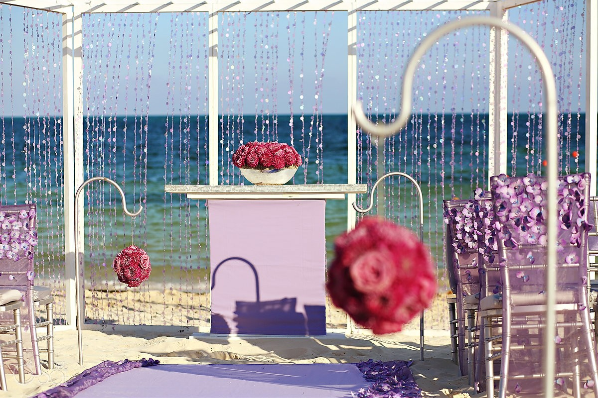 Purple pink Mexico beach wedding chuppah Moon Palace