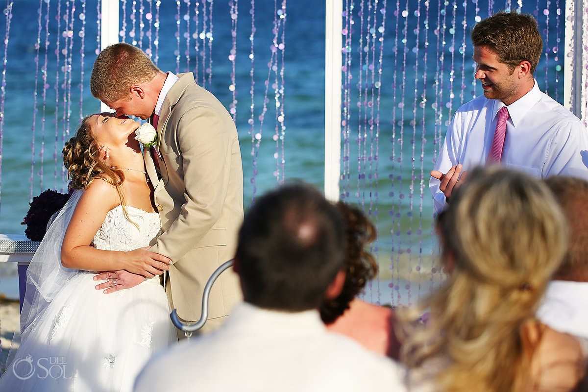 Bride and groom beach wedding kiss