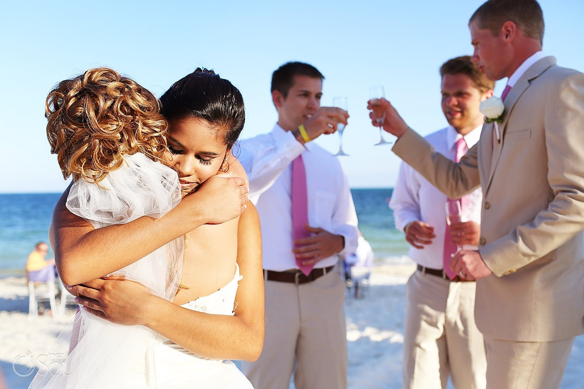 Cancun beach wedding bride hug