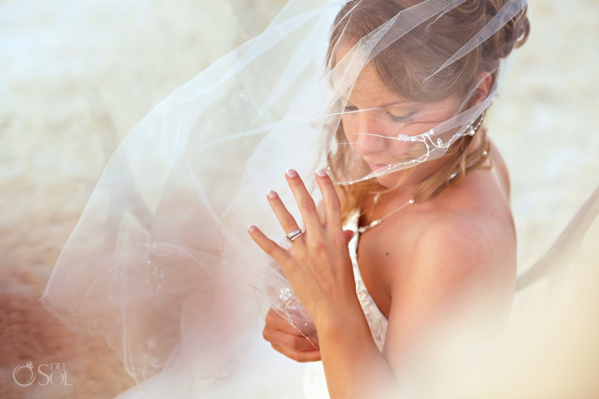 Bride veil blowing on beach