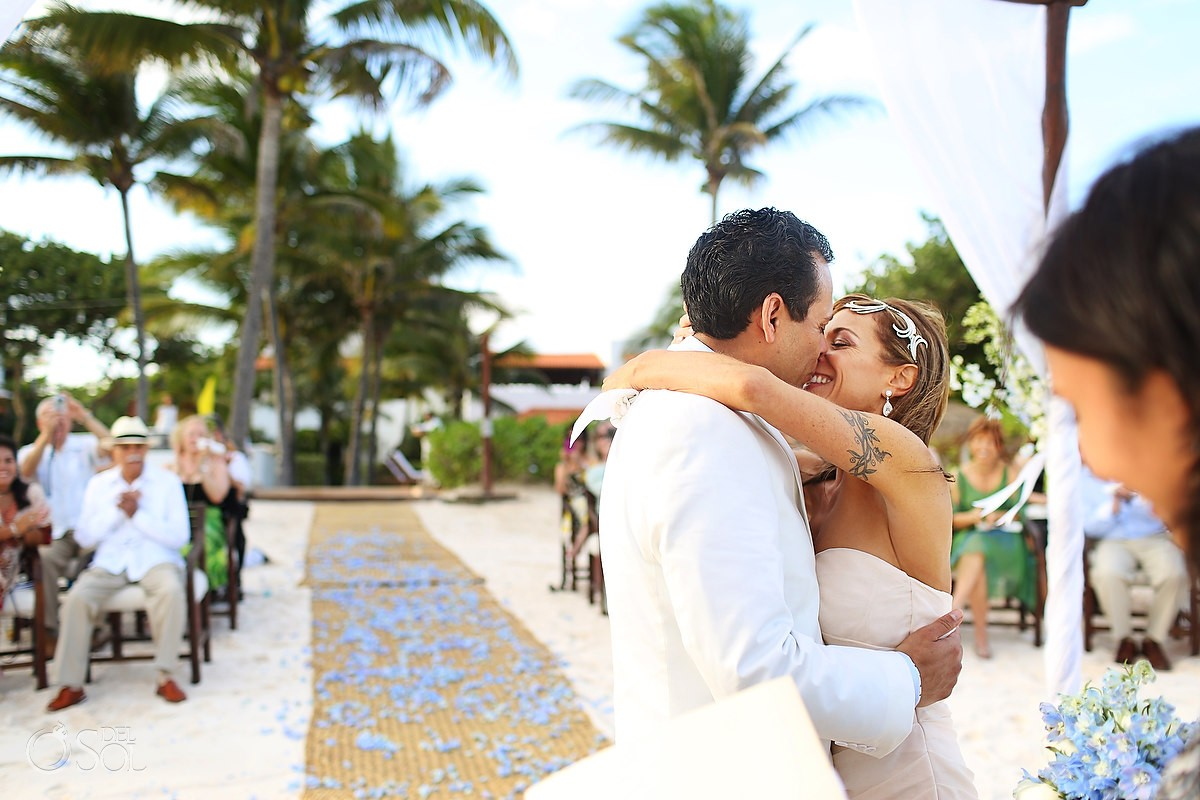 bride and groom first kiss at hotel esencia