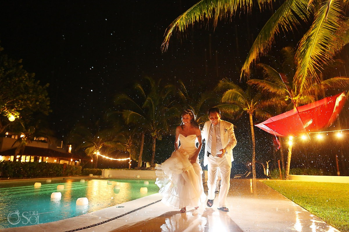 bride and groom in the rain at hotel esencia
