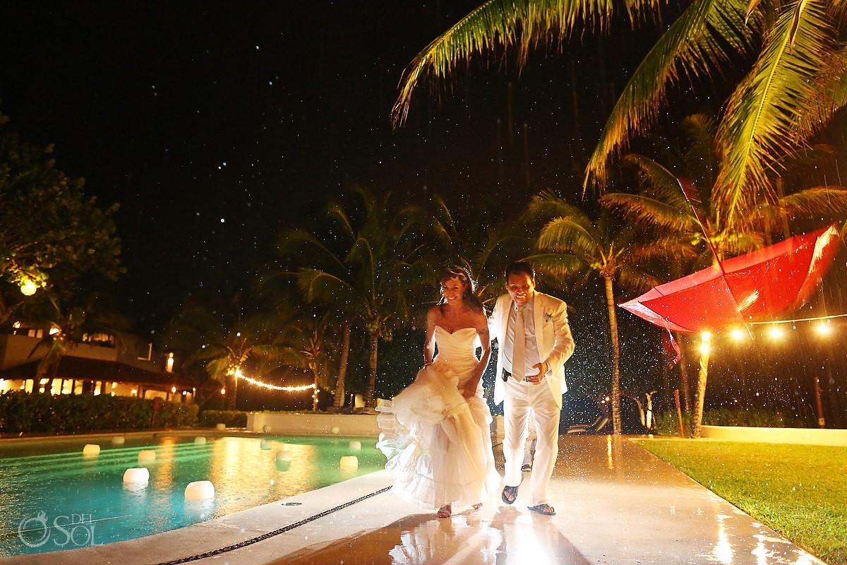 bride and groom in the rain at hotel esencia