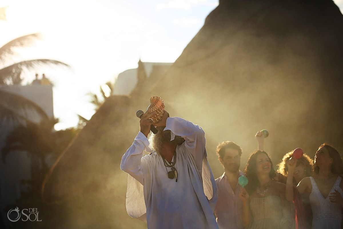 Cosmic Wedding Shaman blowing conch copal smoke, Belmond Maroma Riviera Maya, Mexico