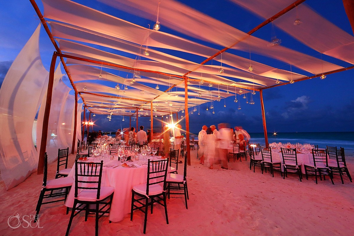 Beach wedding reception set up dusk evening tables fabric pink lighting, Belmond Maroma Riviera Maya, Mexico