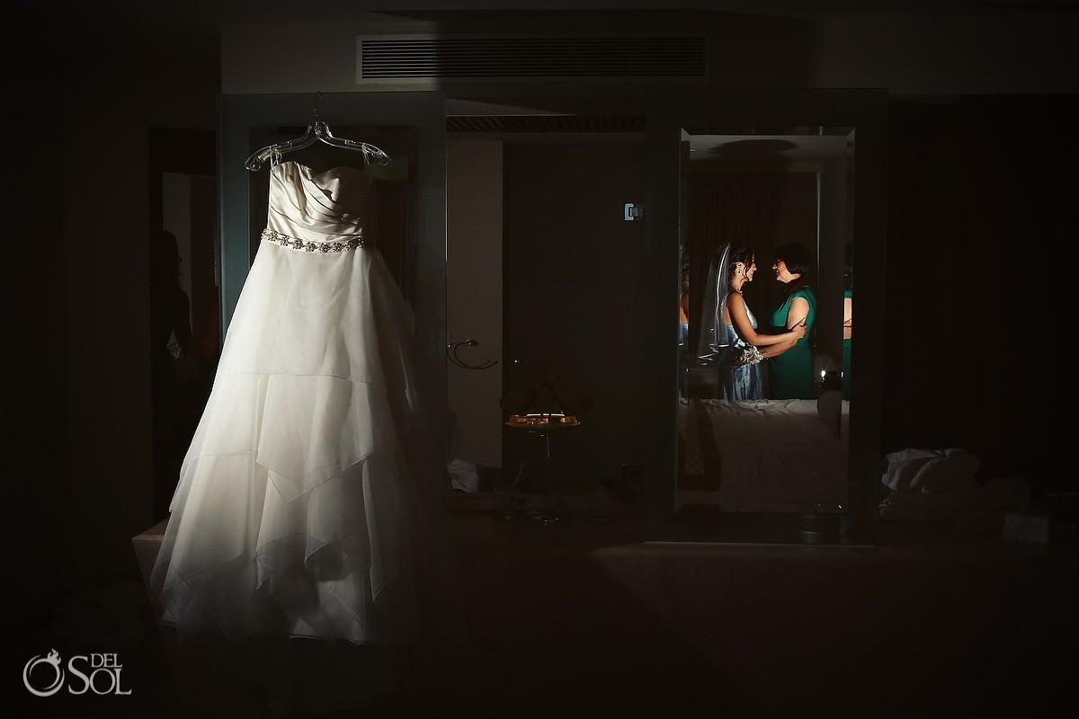 Bride and mother background wedding dress hanging