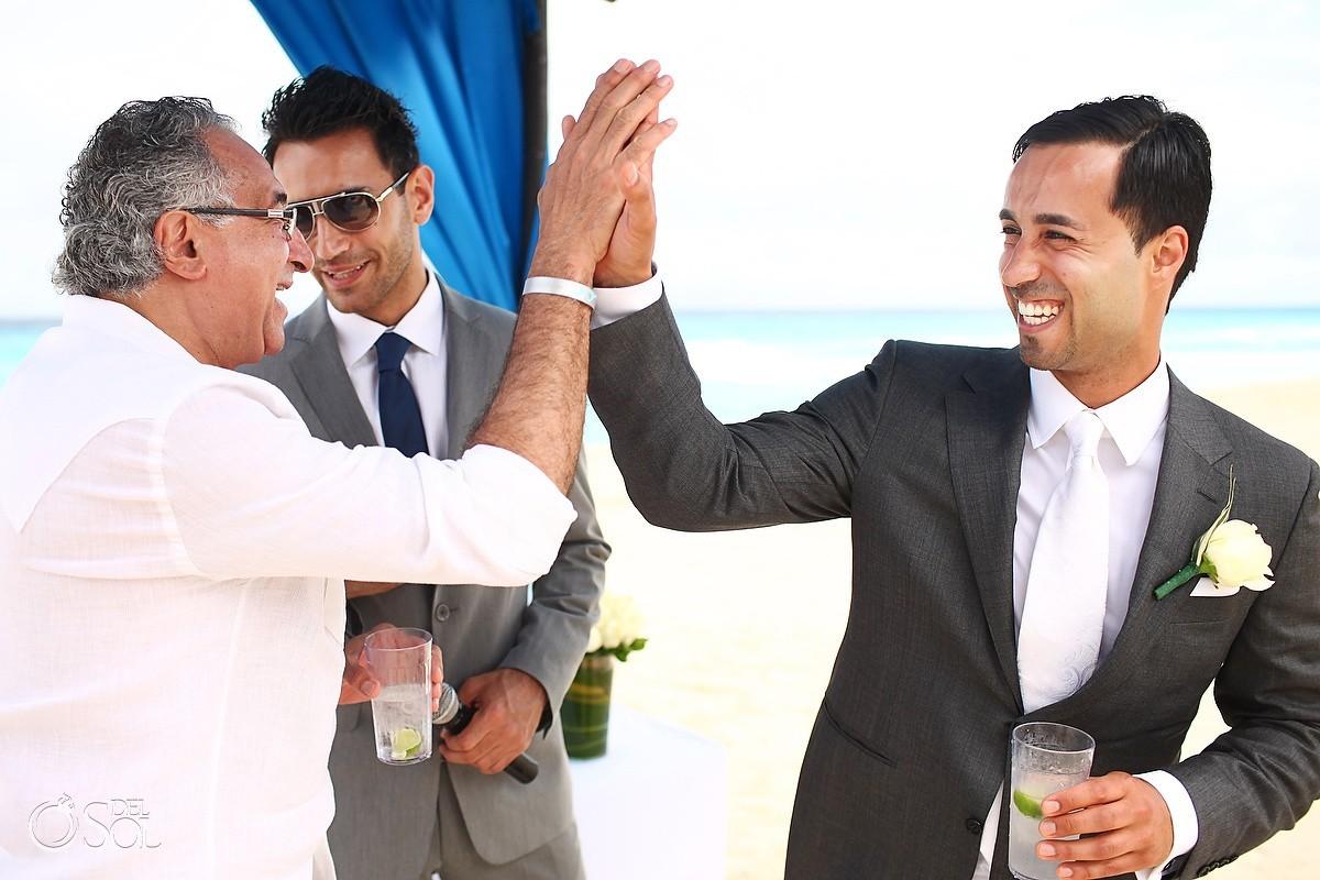 High five at a Cancun beach wedding