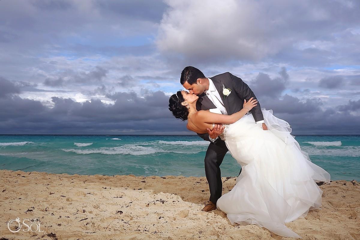 Cancun beach groom dipping bride