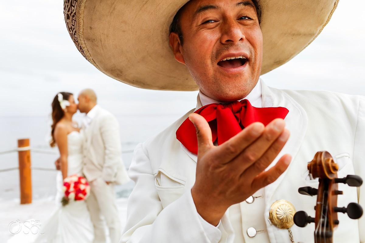 mariachi serenading besa mucho to bride and groom at Dreams Puerto Aventuras wedding