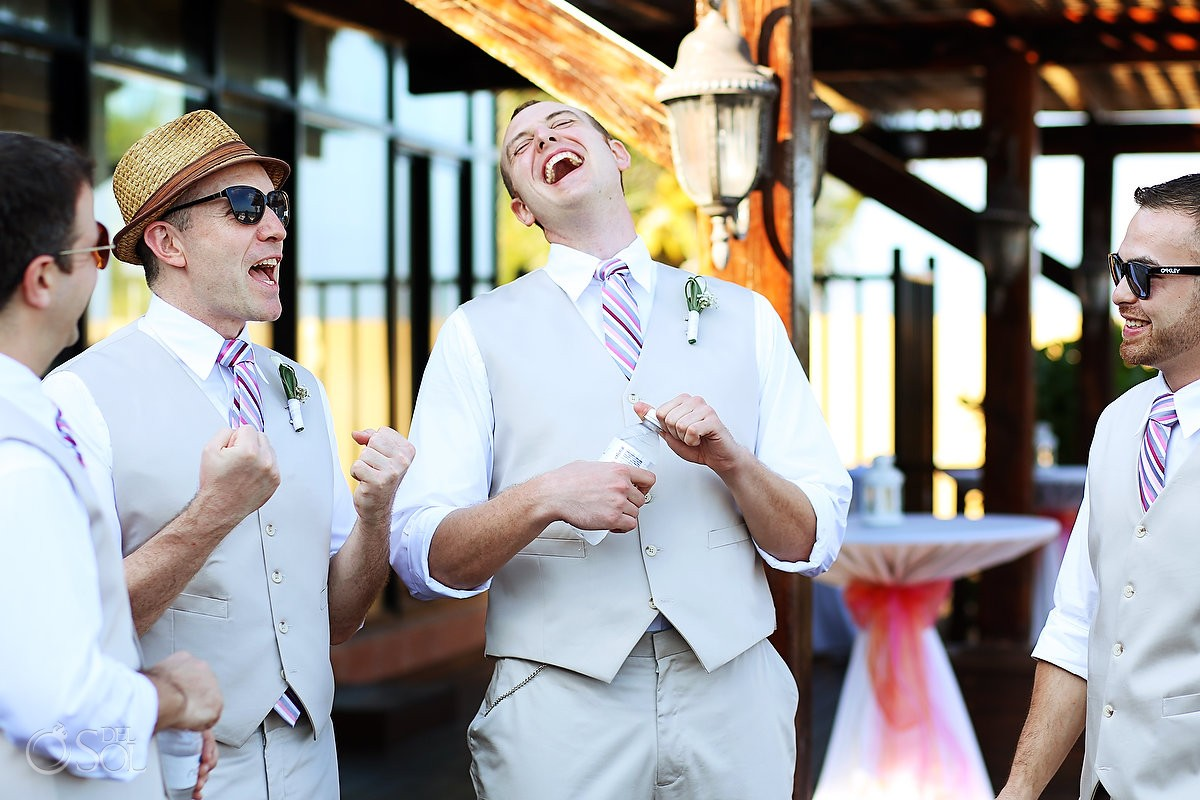 Groom having a laugh before his destination wedding in Mexico