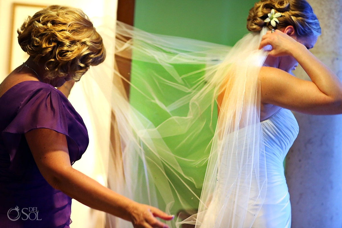 Bride getting her veil ready at a destination wedding in Mexico