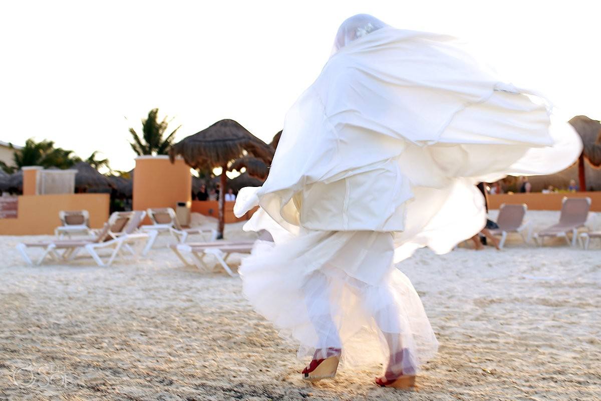 Bride's gown gets blown over her head in a beach wedding