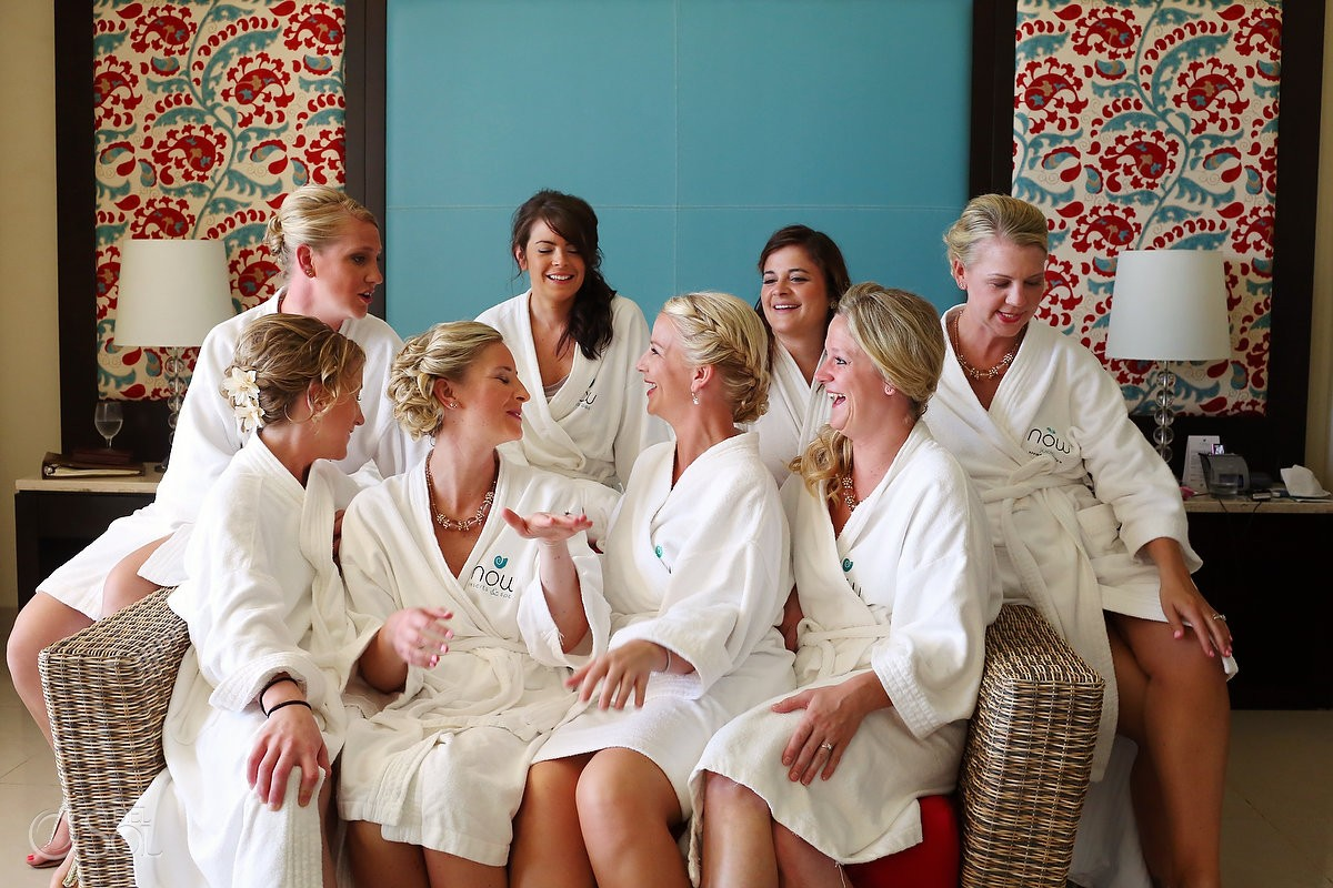 Blonde bride and bridesmaids in hotel robes getting ready