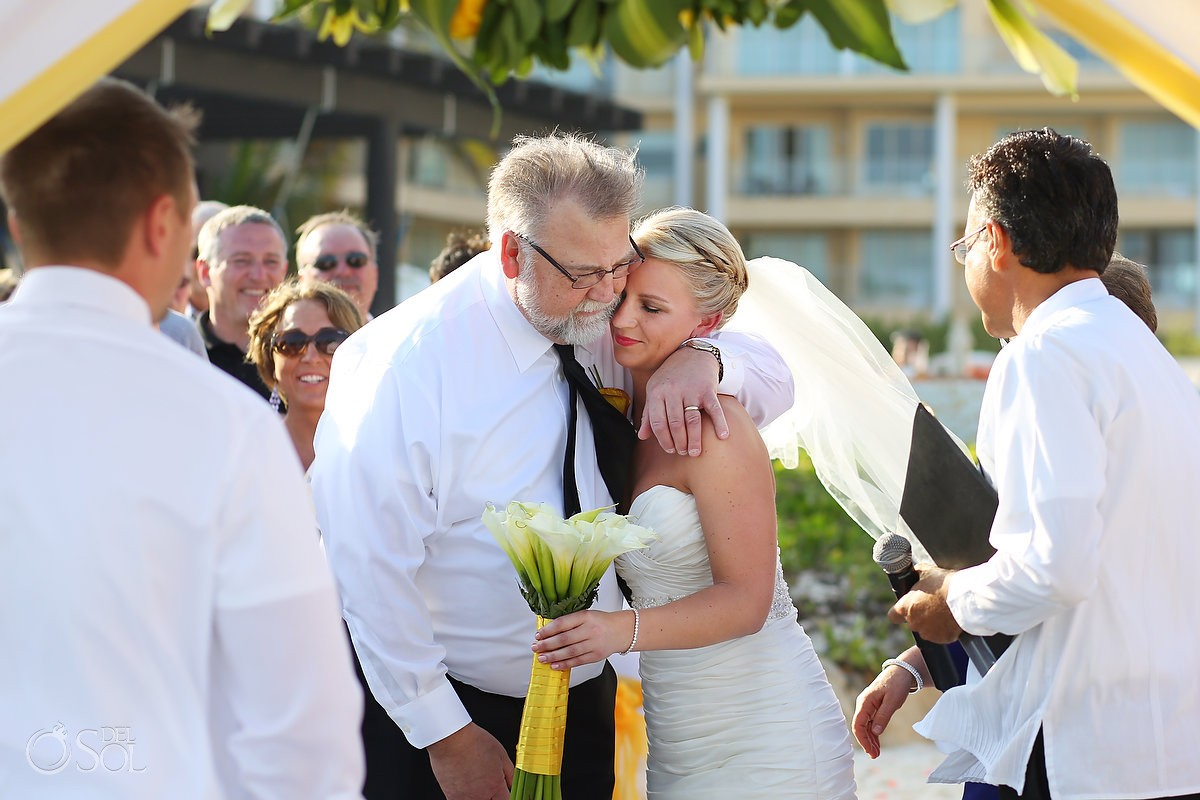 Embrace of father giving away bride