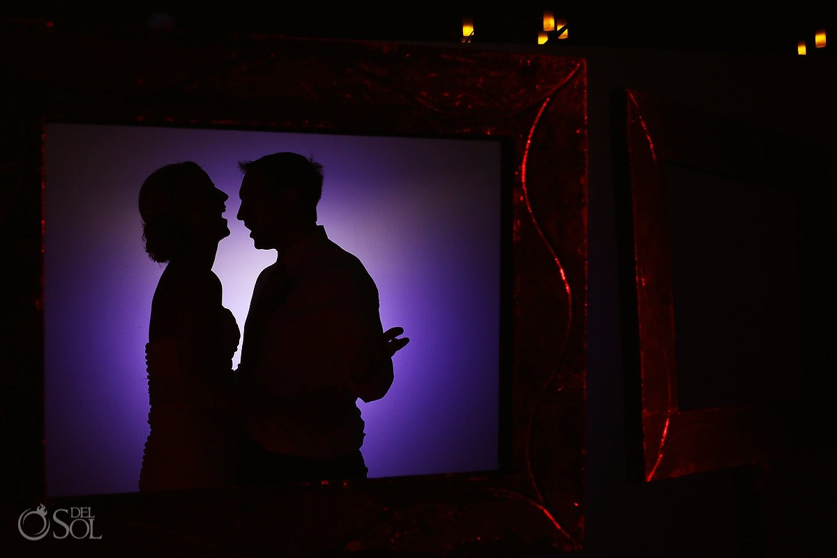 Purple light silhouette of bride and groom