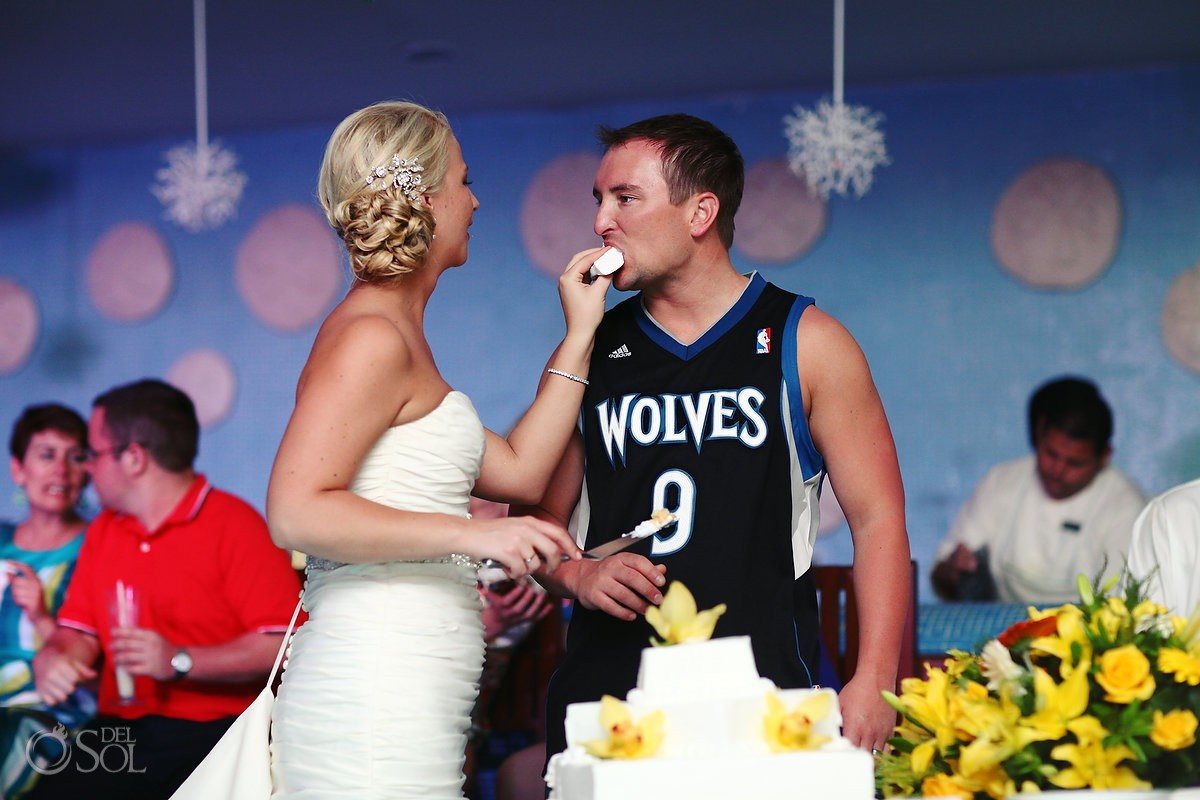 Bride feeds cake to groom in Minnesota Timberwolves jersey