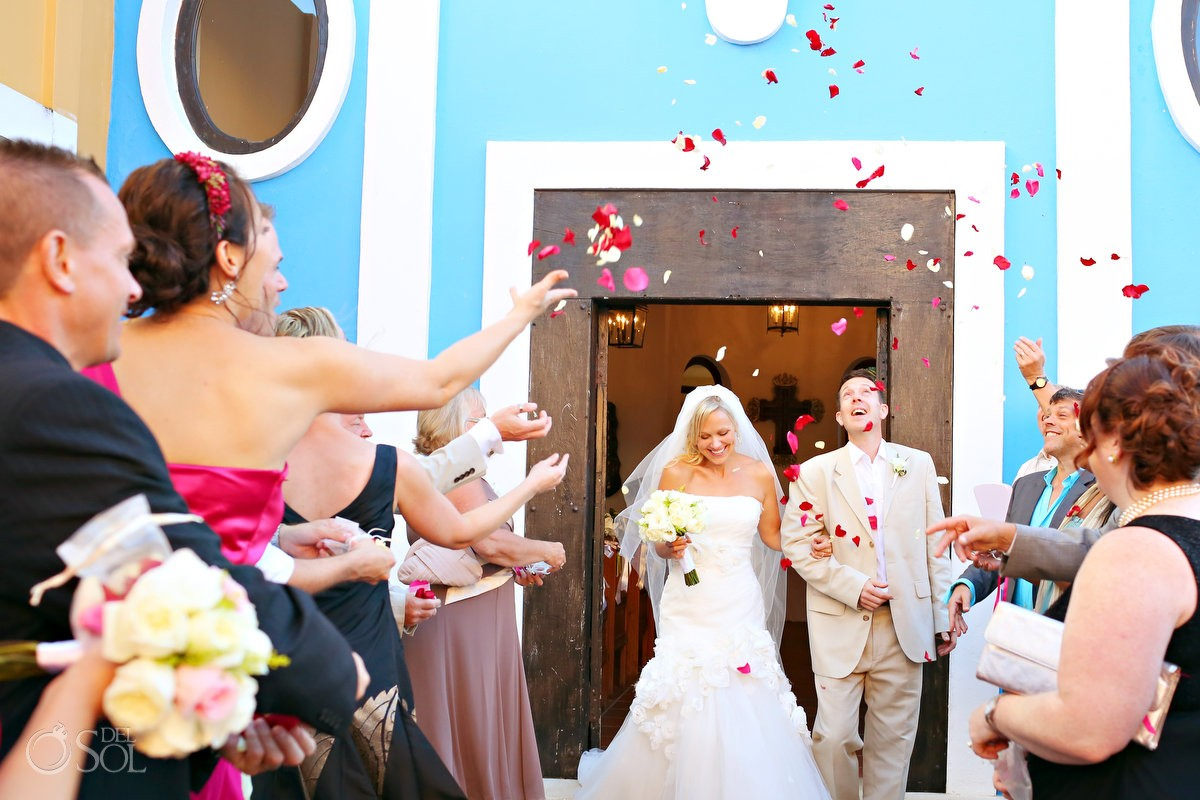 destination wedding chapel with bride and groom rose petal recessional