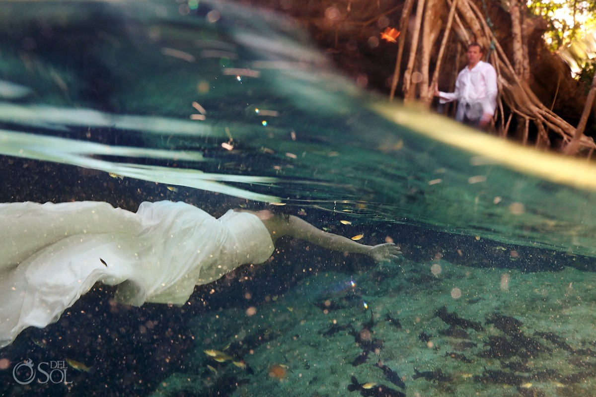 Underwater bride in a Riviera Maya cenote trash the dress photo shoot