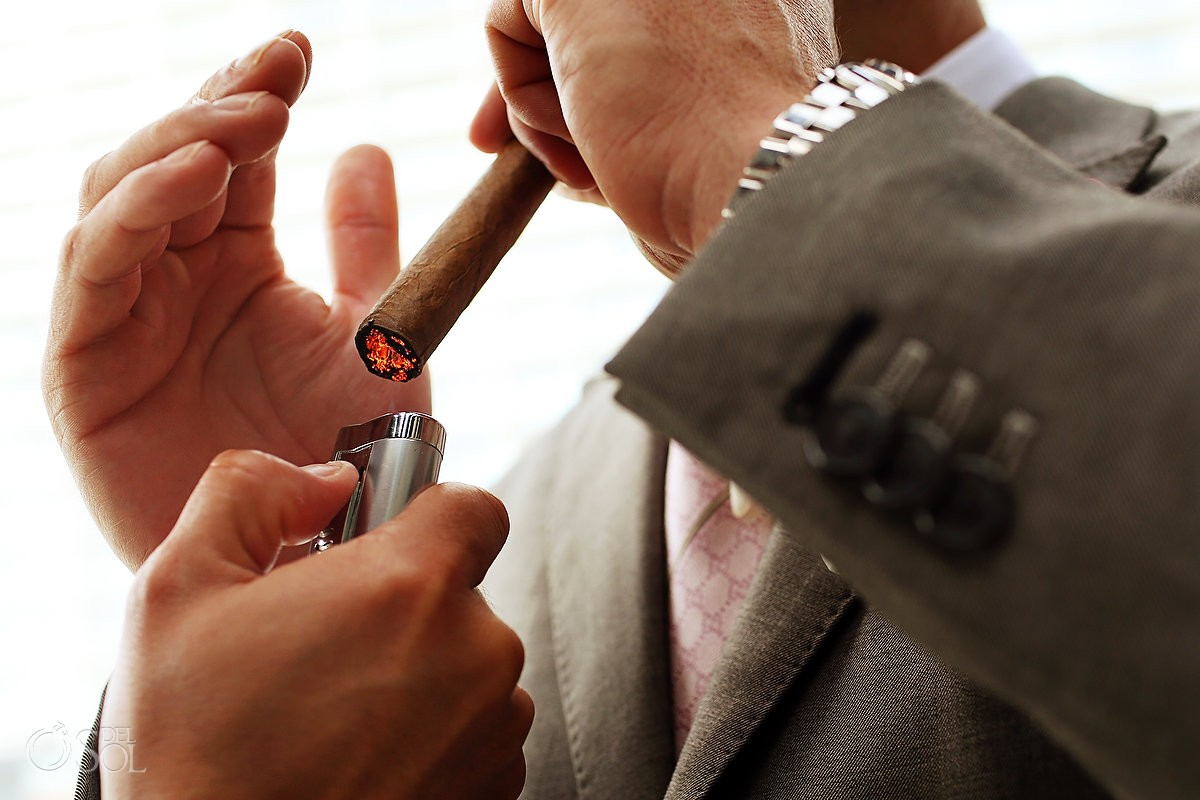 Cancun groom lighting cigar