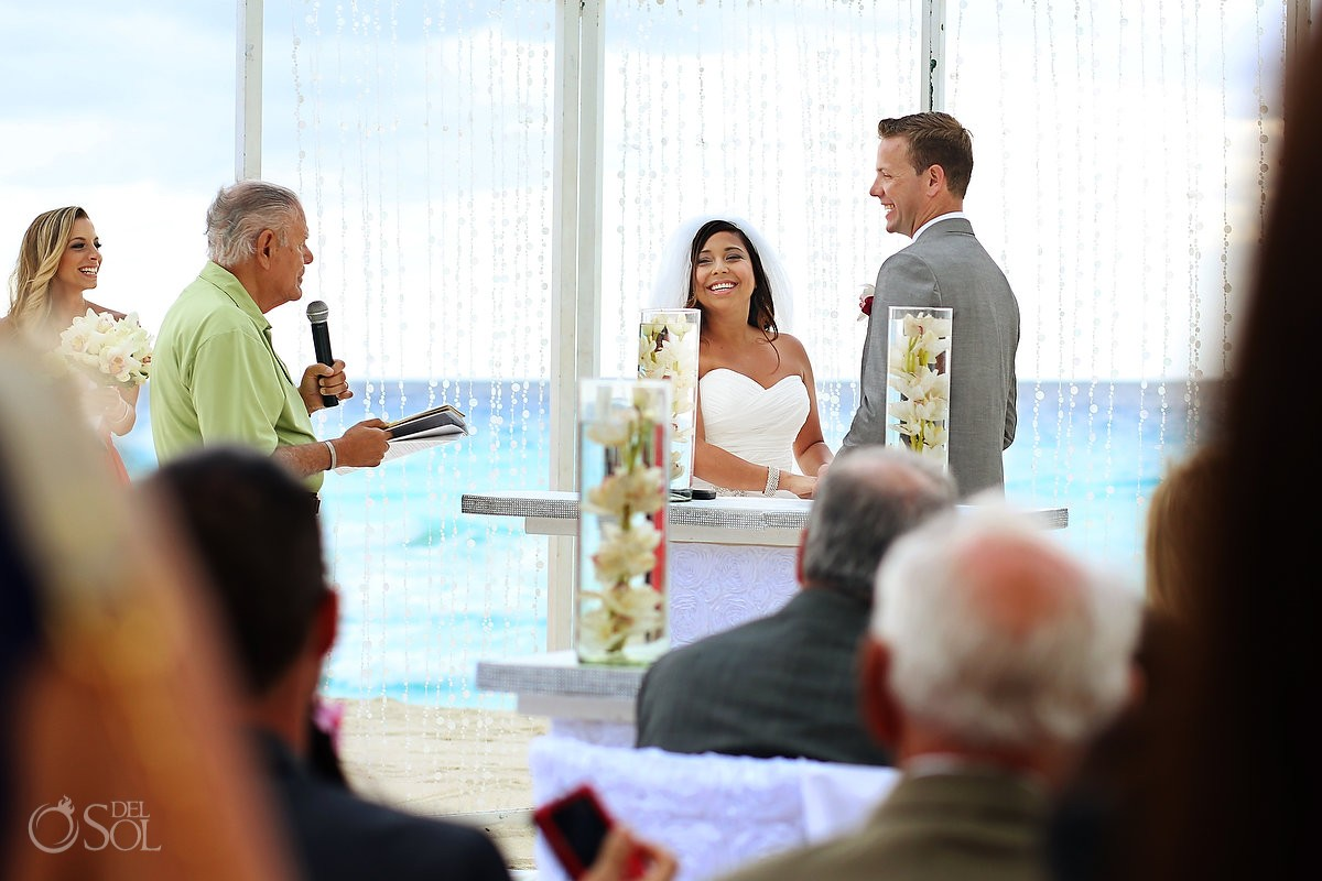 Beach wedding Cancun vows bride and groom