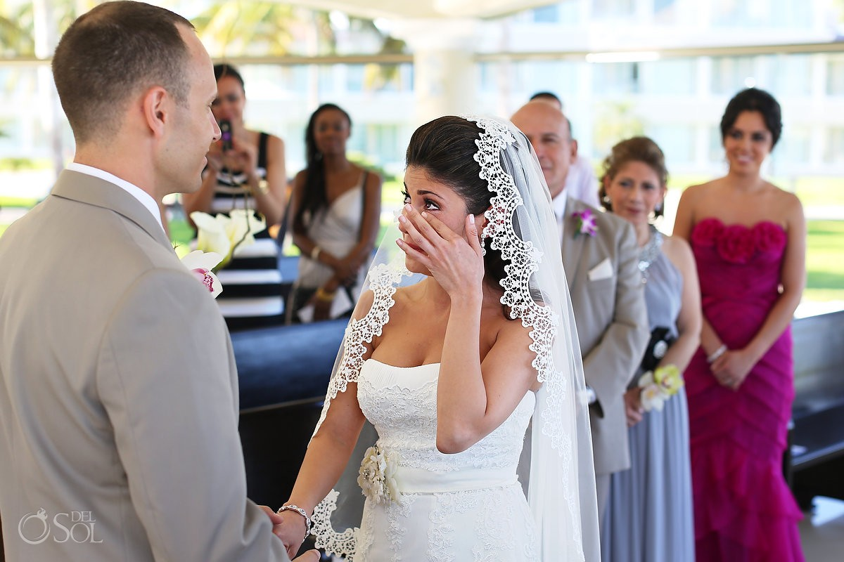 Bride crying at destination wedding Cancun