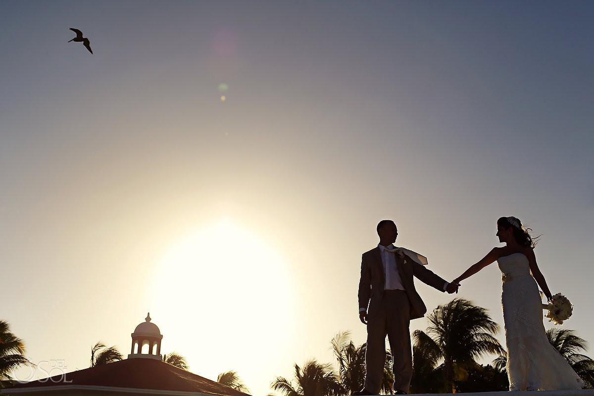 Silhouette of bride and groom at a destination wedding in Cancun