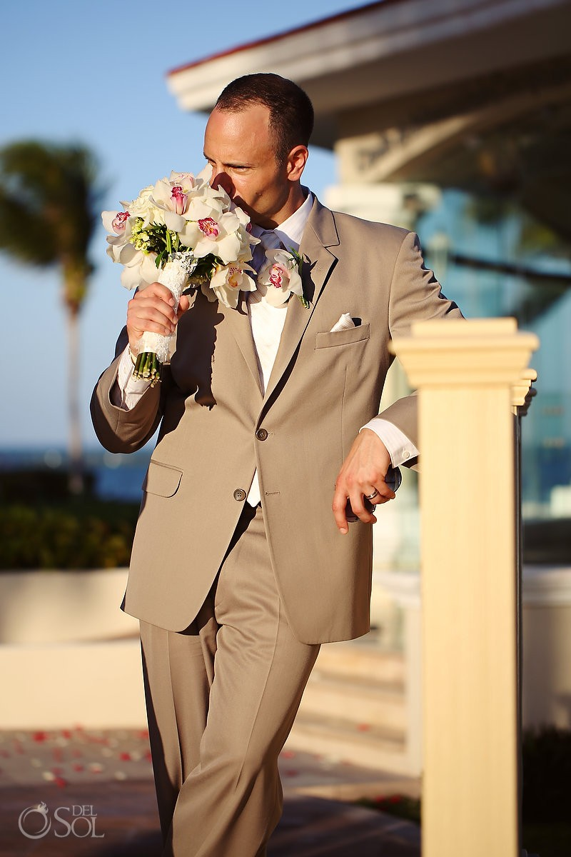 Cancun destination wedding groom with bouquet of flowers