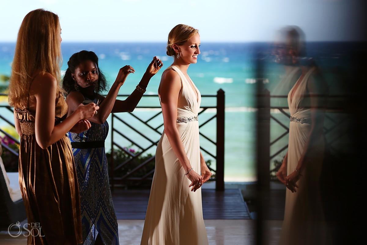Bride before her beach wedding with ocean in background