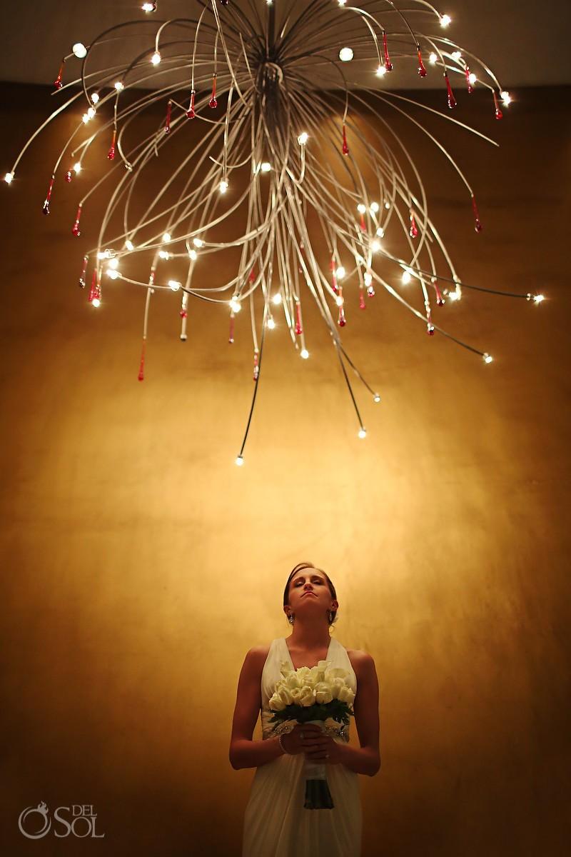 Bride under chandelier at Grand Velas Resort Riviera Maya